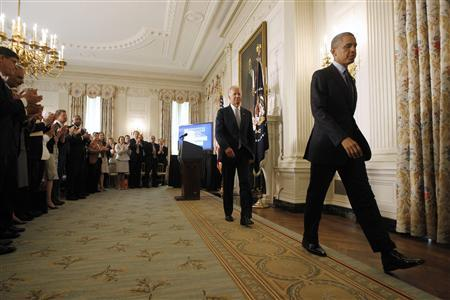 U.S. President Barack Obama (R) leaves with Vice President Joe Biden (2nd L) after delivering remarks on his management agenda in the State Dining room of the White House in Washington, July 8, 2013. REUTERS/Jason Reed
