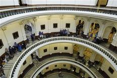Anti-abortion advocates wait in line for a seat in the gallery of the House of Representatives as they prepare to meet and vote on legislation restricting abortion rights in Austin, Texas July 9, 2013. REUTERS/Mike Stone