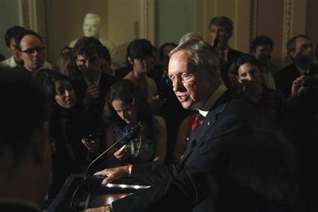 U.S. Senate Majority Leader Harry Reid (D-NV) addresses reporters after the weekly Democratic caucus luncheon at the U.S. Capitol in Washington June 25, 2013. REUTERS/Jonathan Ernst