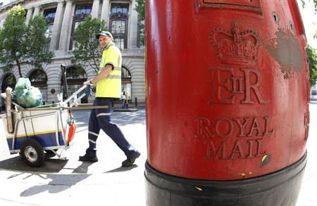 A street cleaner passes a Royal Mail post box in central London June 14, 2011. REUTERS/Chris Helgren