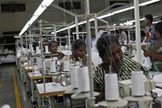 Employees sew clothes at the Estee garment factory in Tirupur, in the southern Indian state of Tamil Nadu June 19, 2013. REUTERS/Mansi Thapliyal