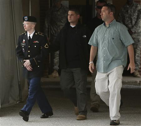 U.S. Army Private First Class Bradley Manning (L) is escorted out after a day of testimony at his court martial trial at Fort Meade, Maryland, July 8, 2013. REUTERS/Jonathan Ernst