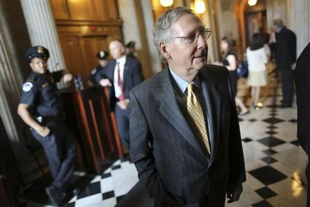 U.S. Senate Minority Leader Mitch McConnell (R-KY) walks to lunch after a procedural vote to move forward on immigration reform legislation at the U.S. Capitol in Washington, June 27, 2013. REUTERS/Jonathan Ernst