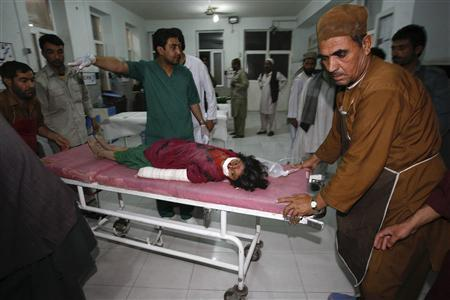 An Afghan girl is wheeled in for treatment at a hospital after a roadside bomb in Herat province July 9, 2013. REUTERS/Mohammad Shoib