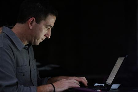 Glenn Greenwald, the blogger and journalist who broke the U.S. National Security Agency (NSA) surveillance scandal, uses his lapton after an exclusive interview with Reuters in Rio de Janeiro July 9, 2013. REUTERS/Sergio Moraes