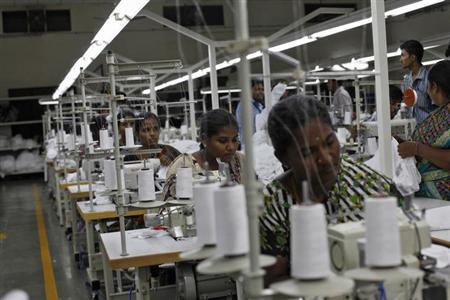 Employees sew clothes at the Estee garment factory in Tirupur, in Tamil Nadu June 19, 2013. REUTERS/Mansi Thapliyal