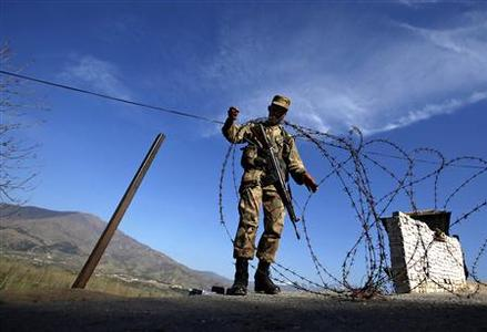 A soldier creates a barrier using barbed wire at a security checkpoint in the Swat valley region, located in Pakistan's restive North West Frontier Province, in this March 19, 2010 file photo. REUTERS-Akhtar Soomro-Files