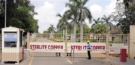 A private security guard stands in front of the main gate of Sterlite Industries Ltd's copper plant in Tuticorin, in Tamil Nadu March 24, 2013. REUTERS/Stringer/Files