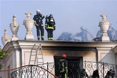 Firemen try to extinguish a fire at the 17th century Hotel Lambert in the Ile Saint Louis in Paris July 10, 2013. REUTERS/Philippe Wojazer