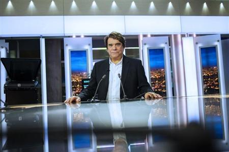 French businessman Bernard Tapie attends the French channel France 2 news evening broadcast in Paris July 1, 2013. REUTERS/Fred Dufour/Pool