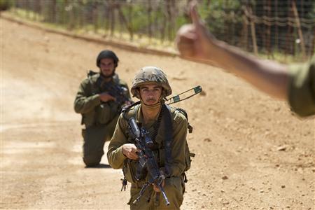 Israeli soldiers patrol along Israel's border with Lebanon near the northern village of Avivim July 3, 2013. REUTER/Baz Ratner
