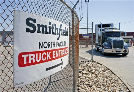 Trucks make their way around the Smithfield Foods packaging plant in Smithfield, Virginia May 30, 2013. REUTERS/Rich-Joseph Facun