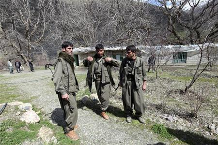 Kurdistan Workers Party (PKK) fighters stand guard at the Qandil mountains near the Iraq-Turkish border in Sulaimaniya, 330 km (205 miles) northeast of Baghdad March 24, 2013. REUTERS/Azad Lashkari
