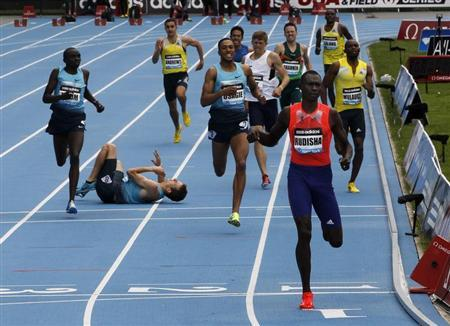 David Rudisha of Kenya (R) wins the men's 800 meters final as Erik Sowiniski of the U.S. (2nd L) falls to the track at the Diamond League Adidas Grand Prix in New York, May 25, 2013. REUTERS/Gary Hershorn