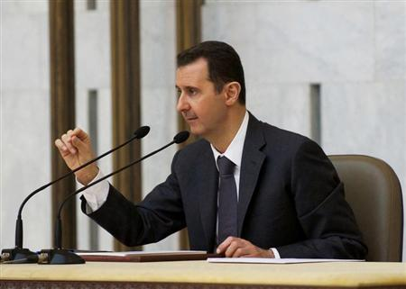 Syria's President Bashar al-Assad heads the plenary meeting of the central committee of the ruling al-Baath party, in Damascus in this handout photograph distributed by Syria's national news agency SANA July 8, 2013. REUTERS/SANA/Handout via Reuters