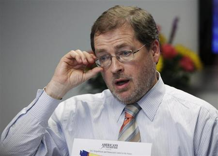 Grover Norquist, founder of the taxpayer advocacy group, Americans for Tax Reform (ATR), adjusts his glasses as he speaks during the Reuters Washington Summit in Washington June 27, 2012. REUTERS/Yuri Gripas