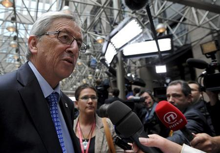 Luxembourg's Prime Minister Jean-Claude Juncker talks to the press at a European Union leaders summit in Brussels June 27, 2013. REUTERS/Laurent Dubrule