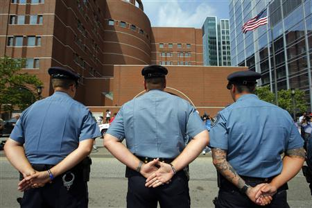 Massachusetts Institute of Technology (MIT) police officers stand outside the federal courthouse for the court appearance by accused Boston Marathon bomber Dzhokhar Tsarnaev in Boston, Massachusetts July 10, 2013. Dzhokhar Tsarnaev made his first court appearance after being charged with killing three marathon spectators on April 15, and later shooting dead a university police officer. REUTERS/Brian Snyder