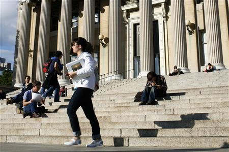 A student walks across the campus of Columbia University in New York, October 5, 2009. REUTERS/Mike Segar