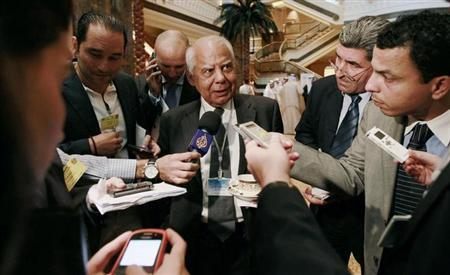 File photo of Egypt's Finance Minister Hazem el-Beblawi speaks to members of the media during a group meeting of Gulf and Arab Finance Ministers in Abu Dhabi, September 7, 2011. REUTERS/Jumana El Heloueh