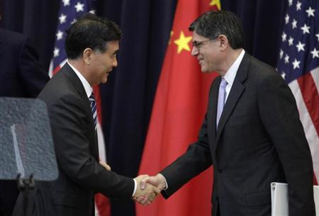 U.S. Treasury Secretary Jack Lew (R) shakes hands with Chinese Vice Premier Wang Yang after the U.S.-China Strategic and Economic Dialogue (S&ED) Joint Opening Session at the State Department in Washington July 10, 2013. REUTERS/Yuri Gripas