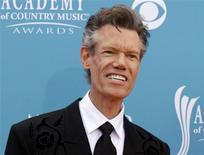 Singer Randy Travis arrives at the 45th annual Academy of Country Music Awards in Las Vegas, Nevada in this April 18, 2010 file photo. REUTERS/Steve Marcus/Files