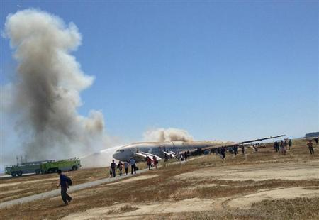 Passengers evacuate from Asiana Airlines Boeing 777 aircraft after a crash landing at San Francisco International Airport in San Francisco, California on July 6, 2013 in this photo courtesy of passenger Eugene Anthony Rah released to Reuters on July 8, 2013. REUTERS/Eugene Anthony Rah/Handout via Reuters