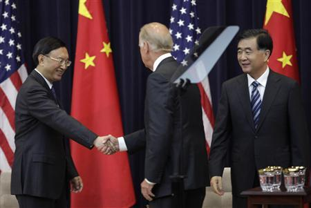U.S. Vice President Joe Biden (C) shakes hands with Chinese State Councilor Yang Jiechi as Chinese Vice Premier Wang Yang (R) look on during the U.S.-China Strategic and Economic Dialogue (S&ED) Joint Opening Session at the State Department in Washington July 10, 2013. REUTERS-Yuri Gripas