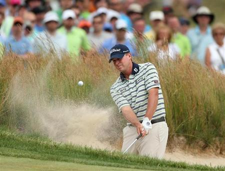 Steve Stricker of the U.S. hits from a bunker on the fourth hole during the final round of the 2013 U.S. Open golf championship at the Merion Golf Club in Ardmore, Pennsylvania, June 16, 2013. REUTERS/Adam Hunger