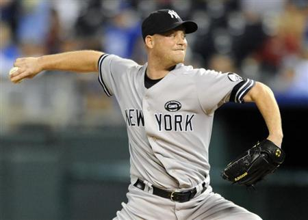 New York Yankees relief pitcher Chad Gaudin delivers a sixth inning pitch against the Kansas City Royals during their rain-delayed MLB American League baseball game in Kansas City, Missouri August 13, 2010. REUTERS/Dave Kaup