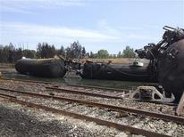 Burnt train cars are seen after a train derailment and explosion in Lac-Megantic, Quebec July 8, 2013, in this picture provided by the Transportation Safety Board of Canada. Canada/Handout via Reuters