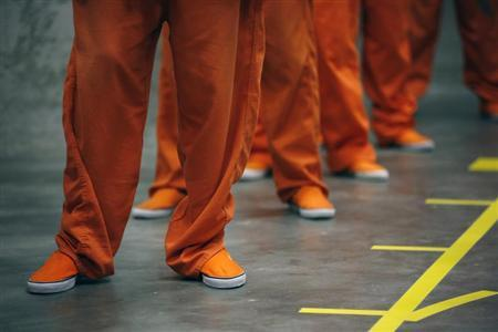 Prison inmates stand in line as they prepare to dance in opposition of violence against women as they participate in a One Billion Rising event at the San Francisco County Jail #5 on Valentine's Day in San Bruno, California February 14, 2013. REUTERS/Stephen Lam