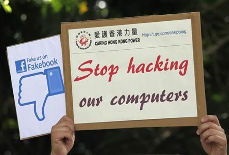 A demonstrator from the pro-China ''Caring Hong Kong Power'' group protests over claims from former U.S. spy agency contractor Edward Snowden that the National Security Agency (NSA) hacked computers in the Chinese territory, outside the U.S. Consulate in Hong Kong July 9, 2013. REUTERS/Bobby Yip