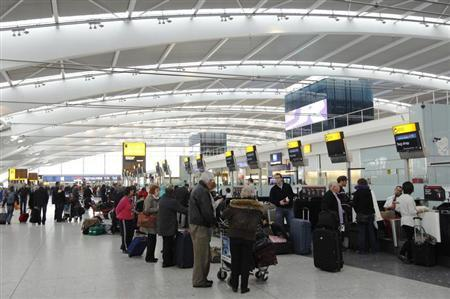 Passengers queue to check in at Terminal 5 at Heathrow airport in London March 16, 2012. REUTERS/Luke MacGregor