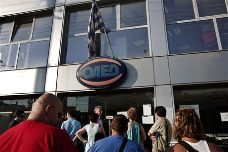 People wait outside a Greek Manpower Employment Organisation (OAED) office in a northern suburb of Athens July 11, 2013. REUTERS/Yorgos Karahalis