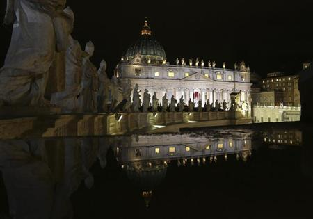 Saint Peter's Basilica is seen reflected from atop the colonnade during the conclave in Saint Peter's Square at the Vatican March 12, 2013. REUTERS/Alessandro Bianchi