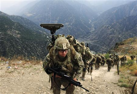 U.S. Army soldiers from Alpha Company 2nd battalion 27th infantry (The Wolfhounds), Task Force No Fear climb upon arrival to Observation Post Mace from Forward Operating Base Bostick in eastern Afghanistan Naray district, Kunar province near border of Pakistan in this August 26, 2011 file photo. REUTERS/Nikola Solic/Files
