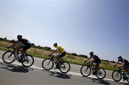 Race leader yellow jersey holder Team Sky rider Christopher Froome of Britain cycles with team mates during the twelfth 218km stage of the centenary Tour de France cycling race from Fougeres to Tours July 11, 2013. REUTERS/Jacky Naegelen