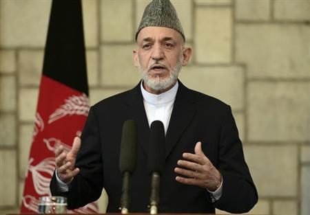 Afghan President Hamid Karzai talks during a joint news conference with British Prime Minister David Cameron at the Presidential Palace in Kabul June 29, 2013 file photo. REUTERS/Massoud Hossaini/Pool
