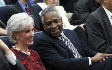 U.S. Secretary of Health and Human Services Kathleen Sebelius (L) smiles with Todd Jones, Acting Director of the U.S. Bureau of Alcohol, Tobacco and Firearms as President Barack Obama asks that the U.S. Congress confirm Jone's permanent appointment as part of a series of proposals to counter gun violence submitted by Obama at the White House in Washington, January 16, 2013. REUTERS/Jason Reed