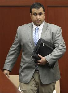 George Zimmerman leaves the courtroom after the state's closing arguments during his trial in Seminole circuit court in Sanford, Florida July 11, 2013. REUTERS-Gary W. Green-Pool
