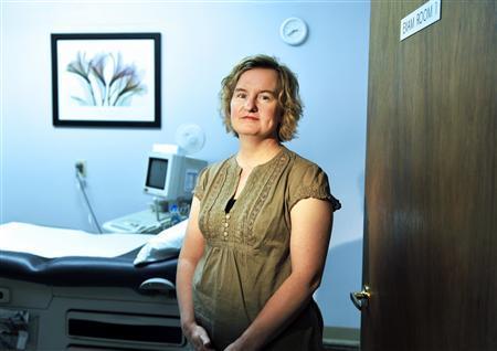 Tammi Kromenaker, director of the Red River Women's Clinic, poses for a photograph in Fargo, North Dakota July 2, 2013. REUTERS/Dan Koeck