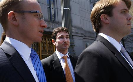 Former Goldman Sachs Group Inc. trader Fabrice Tourre (C) leaves the United States Court in New York City, April 26, 2013. REUTERS/Mike Segar