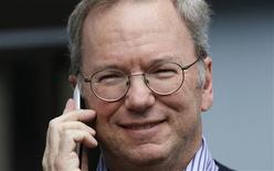 Eric Schmidt, executive chairman of Google, talks on the new yet to be released Google produced Moto X phone at the annual Allen and Co. conference in Sun Valley, Idaho Resort July 11, 2013. REUTERS/Rick Wilking