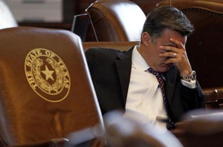 Texas State Democratic Representative Roland Gutierrez listens to discussion of the proposed HB2 abortion restriction as the state legislature meets to consider legislation restricting abortion rights in Austin, Texas July 9, 2013. REUTERS/Mike Stone