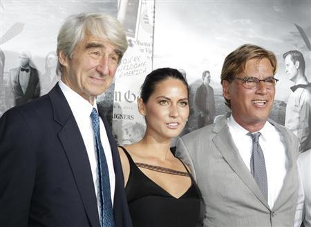 Aaron Sorkin (R), creator and executive producer, and actors Sam Waterston and Olivia Munn arrive for the season 2 premiere of their HBO drama series ''The Newsroom'' in Hollywood July 10, 2013. REUTERS/Fred Prouser