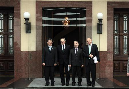 Foreign ministers, Venezuela's Elias Jose Jaua (L-R), Uruguay's Luis Almagro, Brazil's Antonio Patriota and Argentina's Hector Timerman, pose for the media before a Mercosur trade block (Argentina, Brazil, Paraguay and Venezuela) foreign ministers' meeting, in preparation for a Mercosur presidential summit, in Montevideo July 11, 2013. REUTERS/Andres Stapff