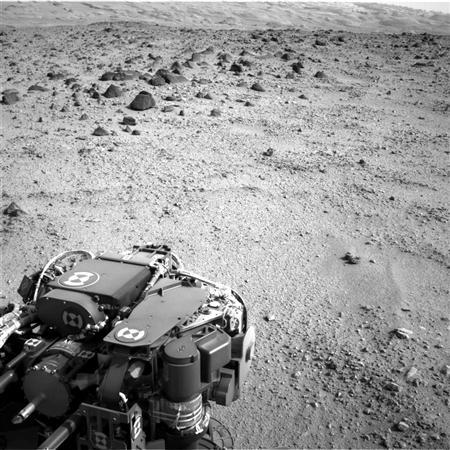 The lower slopes of Mount Sharp appear at the top of this picture taken by the right Navigation Camera (Navcam) of NASA's Mars rover Curiosity at the end of a drive of about 135 feet (41 meters) during the 329th Martian day, or sol, of the rover's work on Mars in this July 9, 2013 NASA handout image. REUTERS/NASA/JPL-Caltech/Handout via Reuters