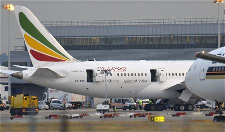 Emergency services attend to a Boeing 787 Dreamliner, operated by Ethiopian Airlines, after it caught fire at Britain's Heathrow airport in west London July 12, 2013. The Dreamliner caught fire at Heathrow airport on Friday in a fresh blow for the U.S. planemaker which earlier this year was forced to ground the new planes for three months because of overheating batteries. There were no passengers aboard the plane. REUTERS/Toby Melville