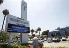 A man walks past the Church of Scientology of Los Angeles building in Los Angeles, California July 3, 2012. REUTERS/Mario Anzuoni